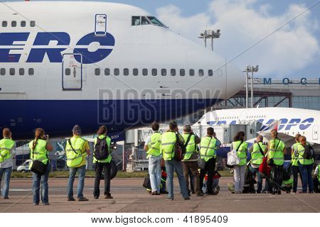 MOSCOW - SEP 1: Group of spotters at airport Domodedovo, Sep 1, 2011, Moscow, Russia. Spotting organized by press service of Domodedovo airport with airline UTair.