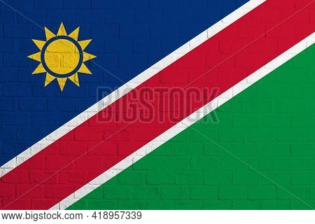 Flag Of Namibia. Brick Wall Texture Of The Flag Of Namibia.