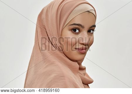 Portrait Of Happy Young Arabian Girl In Traditional Hijab Smiling At Camera On White Background. Bea