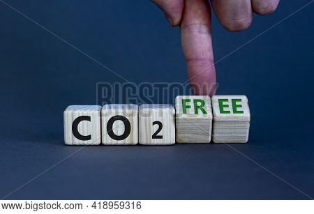 Co2 Free Symbol. Businessman Turns Cubes, Changes Concept Words 'co2' To 'co2 Free'. Beautiful Grey