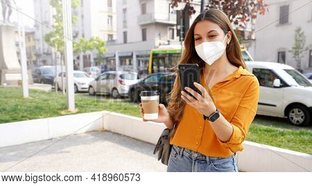 Business Woman With Kn95 Ffp2 Face Mask Standing And Using Smartphone App In City Street