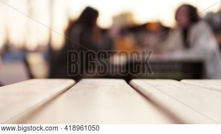 Blurred Abstract Background With Street Food Court. Food Court Table And Visitors. Blur Urban Life S