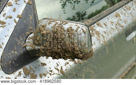 Dirty Car Side Mirror Car. The Texture Of Dirt And Dust On A Metal Close-up. Drops And Splashes On A