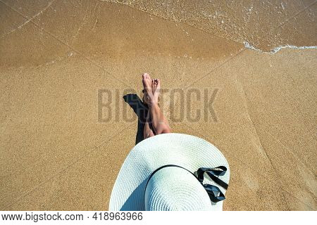Long Slim Young Woman Legs Relaxing Lying Down And Sunbathing On Sand Tropical Beach Under Hot Sun I