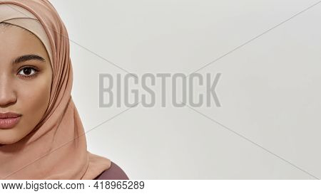 Portrait Of Cute Young Arabian Woman In Traditional Hijab Looking At Camera On White Background With
