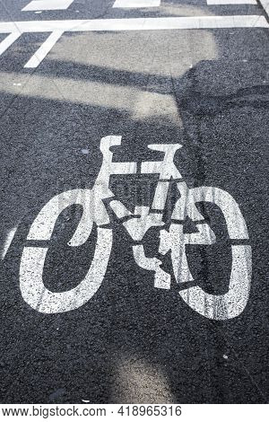 Bicycle Lane Markings On Asphalt Road In European City. Benefit For Cyclists, Convenience And Safety