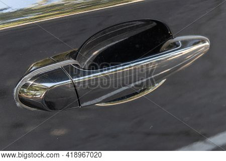 Shiny And Streamlined Door Handle On Exterior Of Black Luxury Car With Clean Lines.
