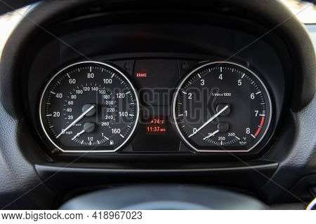 Speedometer And Odometer Readout For Driver Of Luxury Car With Temperature And Time Display.
