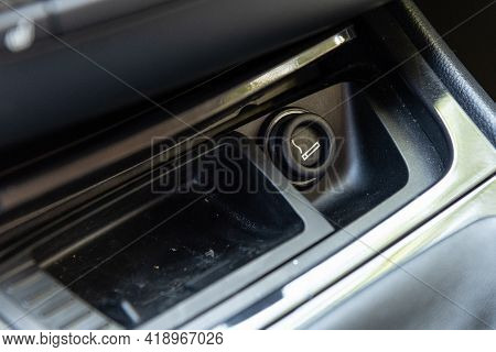 Electronic Cigarette Lighter On Car Dashboard Console Along With Ash Tray For Smoking While Driving.
