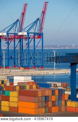 Berthing Container Heavy Cranes For Loading Multi-colored Containers To The Berth Of The Seaport In