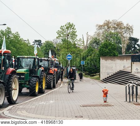 Strasbourg, France - April 30, 2021: People On Bike Near Tractors Roll For Farmer Protest In Front O