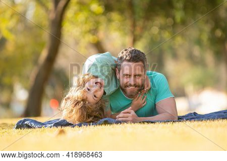 Fathers Day. Happy Family Son Hugs His Dad On Summer Holiday. Kids Love Parents Affection And Tender