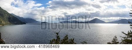 Panoramic View Of Howe Sound And Canadian Mountain Landscape On The West Pacific Coast. Located Betw