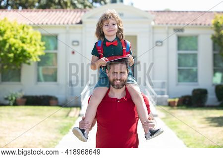 Father Get A Son Pupil Piggyback Ride After Study School. Family, Education And Outdoor Concept.