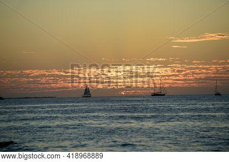 Sailboats With Sails. Ocean Yacht Sailing Along Water.