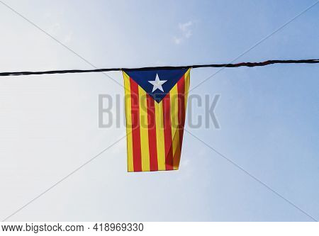 Isolated Catalan Independence Movement Flag Estelada Senyera Banner, Red And Yellow Stripes With Blu