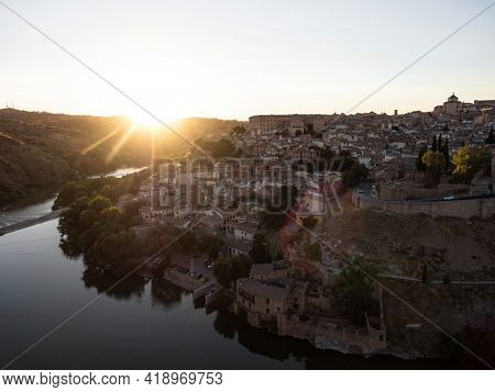Aerial Sunset Panorama View Of Historic Medieval Architecture Toledo Cityscape Skyline At Tagus Rive