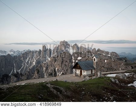 Alpine Panorama Of Cappella Degli Alpini Mountain Chapel In Front Of Cadini Di Misurina Range Group