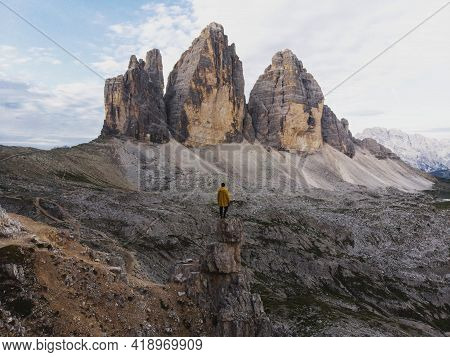 Young Male Hiker Tourist At Infront Of Alpine Panorama Of Tre Cime Di Lavaredo Mountain Peak Summit