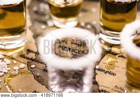 Old Mexico Map With Tequila Glasses Around, Selective Focus, Image In Celebration Of Tequila Day