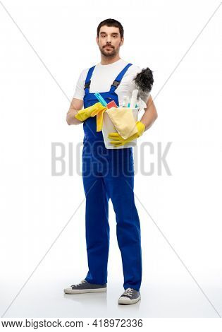profession, service and people - male worker or cleaner in overal and gloves with cleaning supplies over white background