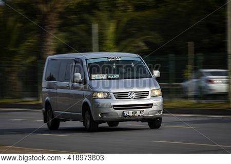 Alanya, Turkey  - April 13  2021:   Silver  Volkswagen Caravelle   Is Driving Fast On The Street On