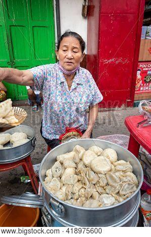A Unidentified Woman Selling Chinese Breakfast At Teretti Bazaar, Kolkata, India On April 2021