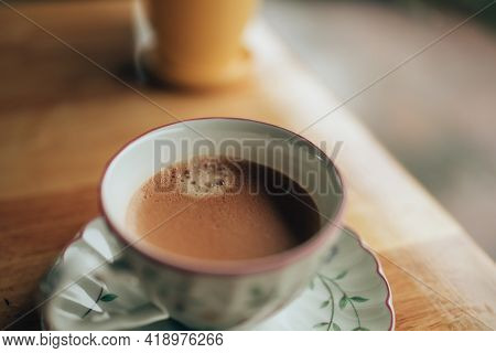 Hot Coffee Americano On The Table. A Cup Of Coffee In  Plate.