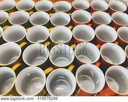 Top View Of White Ceramic Mugs For The Background. Many Ceramic Mugs Are Placed In A Row. Ceramic Cu