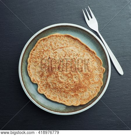 Delicious Organic Spelt Pancake On A Blue Stoneware Plate, Healthy Food, View From Above