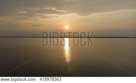 Sunset In River, Scenery Of Sun Reflecting The Water.