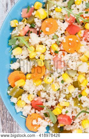 Fresh Salad With Vegetables And Couscous Groats. Light Meal Containing Natural Vitamins And Minerals