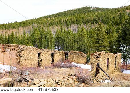 Remnants Of Collapsing Buildings Surrounded By An Alpine Aspen And Pine Forest Taken At The Ghost To