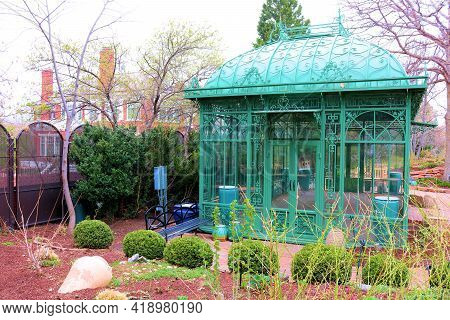 Vintage Glass Building Structure On An Outdoor Patio Taken At A Garden In A Residential Backyard Whi