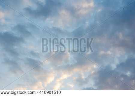 Beautiful Sunset Sky With Multi-colored Fluffy Cumulus Clouds. Heavenly Background For Your Photos.