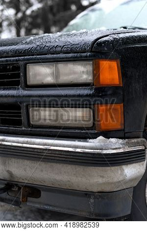 Frozen Car Headlights. Ice And Snow On The Car And Headlights. Suv Headlight. Vertical Photo