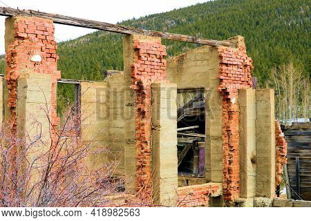 Collapsed Brick Building Surrounded By Mountain Slopes Covered With Pine Forests Taken At The Ghost