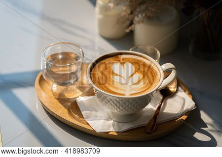 Hot Coffee Latte With Latte Art Milk Foam In Cup Mug With On Marble Floor Background Table In A Coff