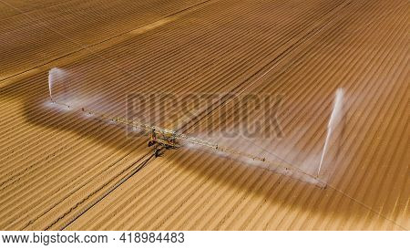 Aerial View Center Pivot Agriculture Irrigation Machine Of Crops. An Irrigation Pivot Watering Agric