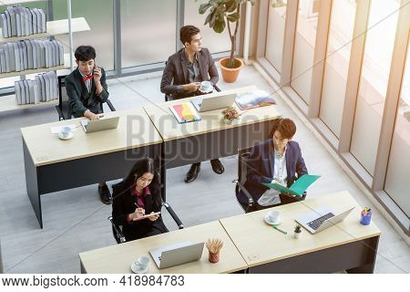 Top View Of Workers Group Of Asian Business People With Diverse Genders (lgbt) Sitting At Desk Worki