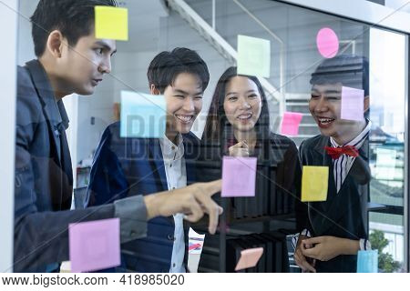 Successful Happy Workers Group Of Asian Business People With Diverse Genders (lgbt) And Use Post It