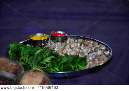 Stock Photo Of Steel Plate Decorated With Auspicious Or Rituals Objects Vermilion, Betel Leafs, Bete