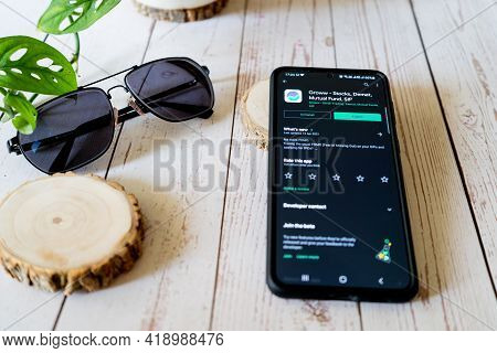Indian Startup Unicorn App Groww Funded Recenlty On A Phone Placed On A Wooden Table With Sunglasses