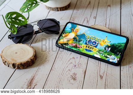 Famous Augmented Reality Virtual Game Pokemon Go Fest Playing On A Mobile Phone On A Wooden Table Ou