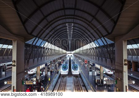 Seville, Spain - January 15, 2016: Passengers Boarding High-speed Trains In Santa Justa Station In S