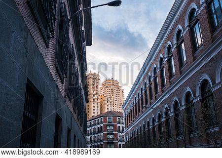 Back View Of The Edificio De España, A Famous Art Deco Skyscraper Located In Plaza De España, As See