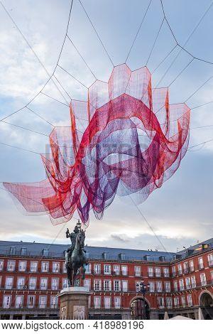 Madrid - February 11, 2018: Janet Echelman 1.78 Colourful Fiber Installation Above The Plaza Mayor S