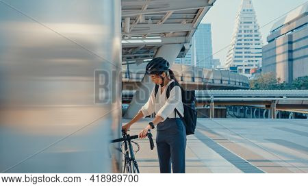 Asian Businesswoman Go To Work At Office Walk And Smile Wear Backpack Look Around Take Bicycle On St