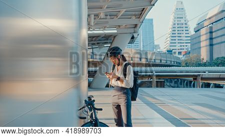 Smile Asian Businesswoman With Backpack Use Smart Phone Look Camera In City Stand At Street With Bik
