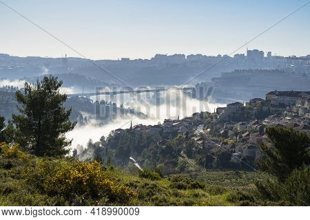 Fog Accumulated In Ravines Around Jerusalem, Israel, On A Cool, Hazy Spring Morning.